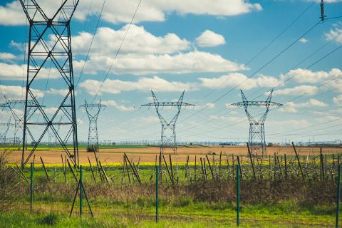 transmission-grids-blue-sky-clouds-green-field